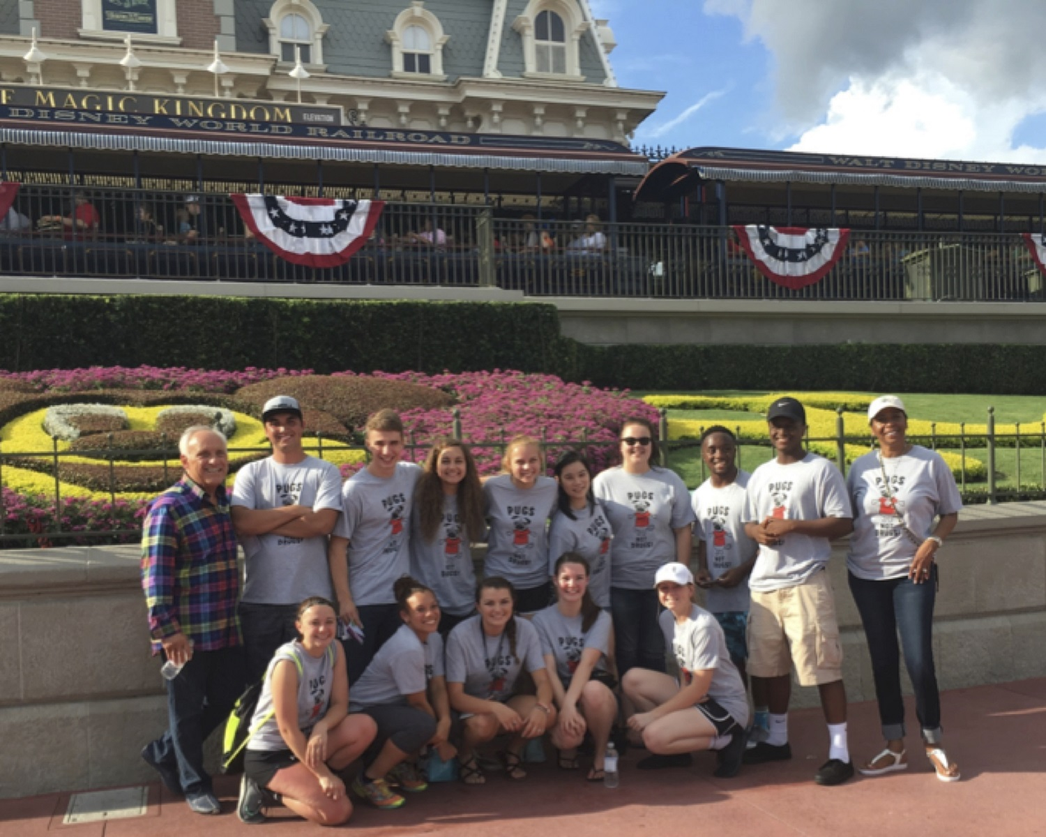 YAB Members at Disney World's Magic Kingdom Park with D.A.R.E. President & CEO Frank Pegueros