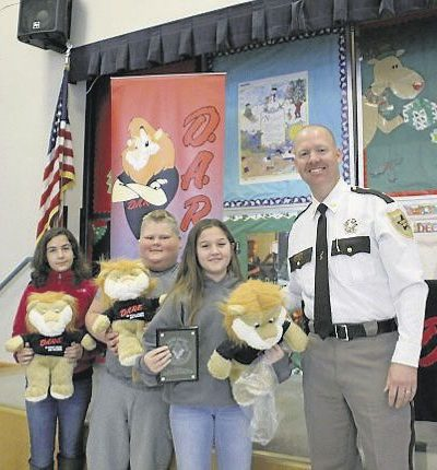 D.A.R.E. Essay Finalists Cady Marrs (from left) and Jacob Willoughby, Essay Winner Karley Campbell and Nelson County Sheriff David Hill at Tye River Elementary School on Dec. 5.